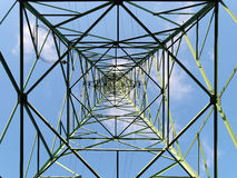 Overhead transmission tower. Steel structure of transmission tower, bottom up view stock images