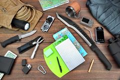 Overhead Travel Backpacking Necessary Items On Grunge Wood Floor. Gear laid Out For A Backpacking Trip On A Rustic Wooden Grunge Floor Or Table. Items Include Royalty Free Stock Images