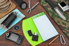 Overhead Travel Trip Backpacking Necessary Items On Wood Table. Gear laid Out For A Backpacking Trip On A Rustic Wooden Grunge Floor Or Table. Items Include stock photo