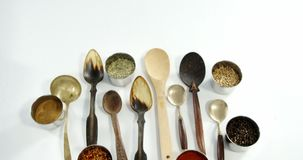 Various type of spoons with spices in bowl 4k. Overhead of various spoons with spices in bowle 2 4k stock video