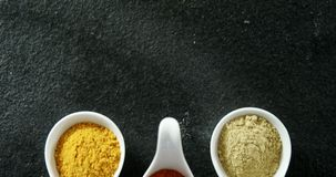 Various type spices on spoon 4k. Overhead of various type spices on spoon 4k stock video