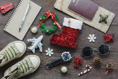 Overhead view of accessory Merry Christmas with items to travel background concept. Royalty Free Stock Photo