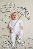 Adorable baby girl sketched as holding umbrella royalty free stock photo