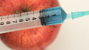 Overhead view of an apple and a syringe Stock Photo