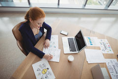 Overhead view of attentive executive working at desk Stock Image