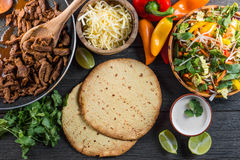 Overhead view on authentic mexican street taco. With beef and vegetables from above on wooden table Royalty Free Stock Photography