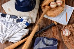 Overhead view of baseball gear on a rustic wood surface stock photography