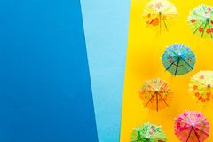Overhead view on beach with umbrellas and sea with boats. Sea travel and summer vacation minimal concept. Paper origami composition. Flat lay. Top view. Copy Stock Photo