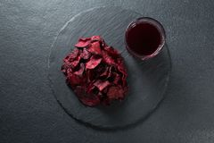 Overhead view of beetroot with juice on plate. Over slate Royalty Free Stock Images
