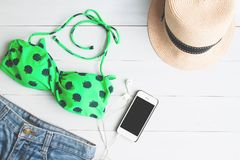 Overhead view of bikini and short jeans, girl accessories with s Royalty Free Stock Photography