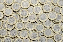 Overhead view of 2017 bimetallic British pound coins. Overhead view of British pound coins. Many in an untidy pile. New UK bimetallic currency introduced in Stock Photos
