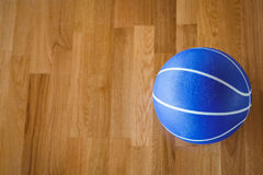 Overhead view of blue basketball on hardwood floor Royalty Free Stock Photo