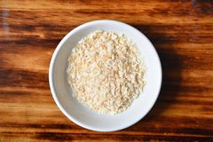 Minced onion. Overhead view of a bowl of minced onion Royalty Free Stock Images