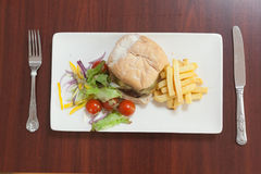 Overhead view of burger with french fries and salad Royalty Free Stock Photography