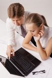 Overhead view of business couple using laptop Stock Image
