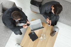 Overhead view of business meeting. Corporate business people working together on meeting overhead view Royalty Free Stock Photography