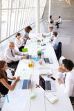 Overhead View Of Business Meeting Around Boardroom Table Royalty Free Stock Photography