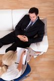Man talking to his psychiatrist Royalty Free Stock Image