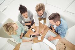 Overhead view of business people with digital tablet in office Royalty Free Stock Images