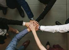 Business team showing unity. Overhead view of business people hands stacked together. Business team showing unity Royalty Free Stock Photography