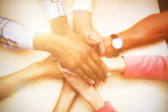Overhead view of business people stacking hands. Overhead view of business people stacking hand at table Royalty Free Stock Images