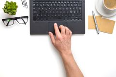 Businessman Touching Touchpad On Laptop At White Desk Stock Image