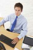 Overhead View Of Businessman Working At Desk Using Digital Table Stock Image