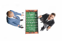 Overhead view of businessmen playing table football together. Isolated on white Stock Images