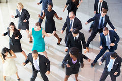 Overhead View Of Businesspeople Dancing In Office Lobby. Having Fun stock photos