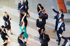 Overhead View Of Businesspeople Dancing In Office Lobby Stock Photos