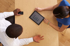 Overhead View Of Businesspeople With Digital Tablet At Desk Stock Photography