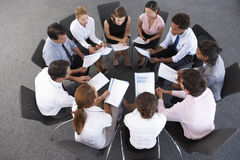 Overhead View Of Businesspeople Seated In Circle At Company Seminar royalty free stock photography