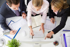 Overhead View Of Businesspeople Working At Office Computer� Stock Photos