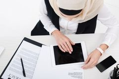 Overhead view of businesswoman using tablet at workplace. With documents Stock Images