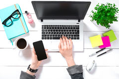 Overhead view of businesswoman working at computer in office Stock Image