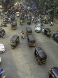 Overhead view of busy road lined with auto-rickshaws stock photo