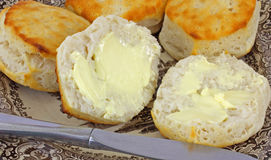 Overhead View Buttered Biscuits. Close overhead view of freshly baked buttered canned biscuits royalty free stock images