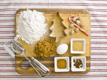 overhead view of cake ingredient with cookie cutter candy cane a Royalty Free Stock Photography