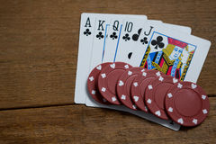 Overhead view of cards and maroon chips Stock Image