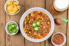 Overhead view of chili for Super Bowl Sunday royalty free stock photo