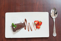 Overhead view of chocolate cake with strawberries Stock Photo