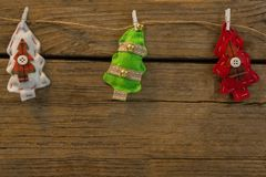 Overhead view of Christmas tree shapes attached with clip on rope. At table Stock Photography