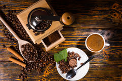 Overhead view of coffee beans by grinder and mug Stock Image