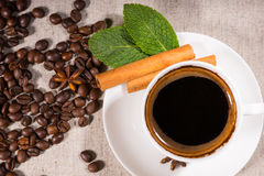 Overhead view of coffee in mug by pile of beans Royalty Free Stock Image