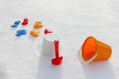 Overhead view on colorful bucket and shovel, covered snow Stock Images