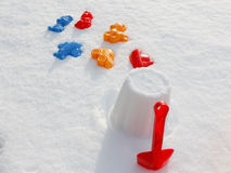 Overhead view on colorful bucket and shovel, covered snow stock photo