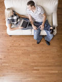 Overhead View of Couple Relaxing on Couch Royalty Free Stock Photo