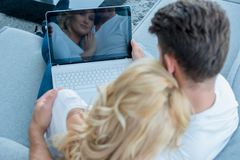 Overhead view of a couple using laptop Royalty Free Stock Image