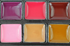 Overhead View Creamy Lip Gloss. A great overhead view of a variety of lip gloss colors Royalty Free Stock Photography
