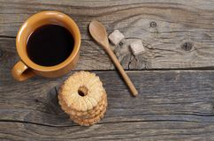 Coffee and stack of shortbread cookies stock images